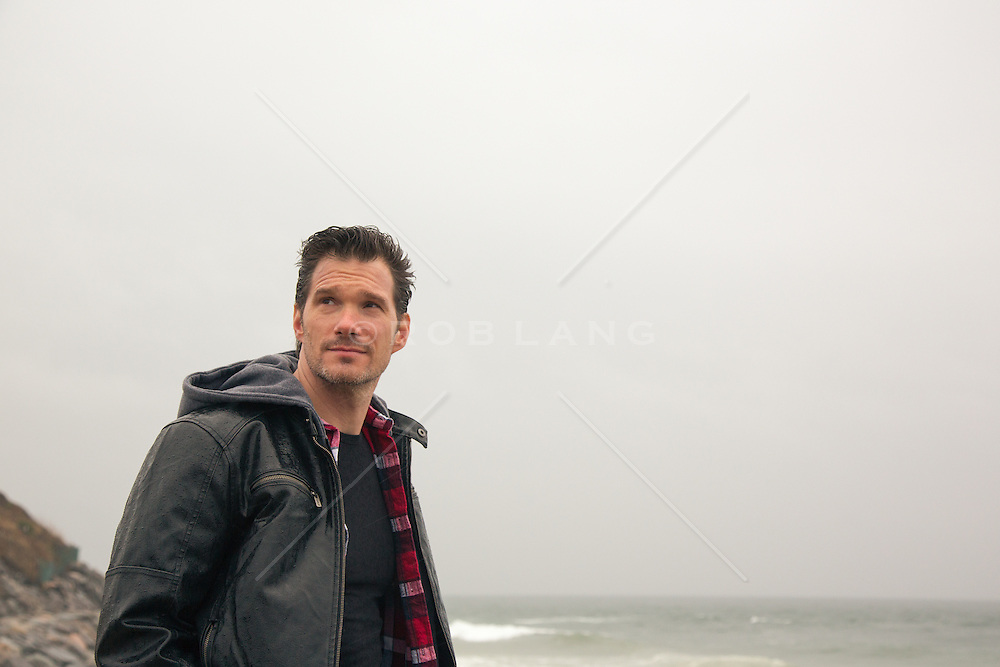 man on the beach in the wintertime