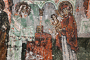 Presentation of Jesus in the temple, fresco, 9th - 11th century, in Karabas Kilise, or the Black Head Church (as the painted figures have been blackened by smoke from oil lamps), in the Soganli Valley in Goreme, in Nevsehir province, Cappadocia, Central Anatolia, Turkey. The churches in Goreme are carved from the soft volcanic tuff created by ash from volcanic eruptions millions of years ago. Early christians came here to flee persecution by the Romans and others settled here under the influence of early saints. This area forms part of the Goreme National Park and the Rock Sites of Cappadocia UNESCO World Heritage Site. Picture by Manuel Cohen