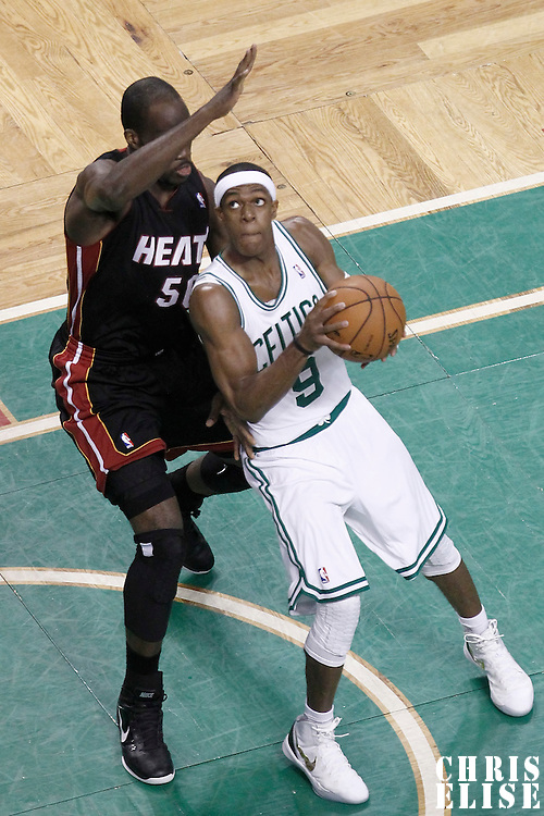 01 June 2012: Boston Celtics point guard Rajon Rondo (9) drives past Miami Heat center Joel Anthony (50) during the first quarter of Game 3 of the Eastern Conference Finals playoff series, Heat vs Celtics, at the TD Banknorth Garden, Boston, Massachusetts, USA.