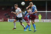 David Mirfin  clears ball from Billy Bingham  during the Sky Bet League 1 match between Scunthorpe United and Crewe Alexandra at Glanford Park, Scunthorpe, England on 15 August 2015. Photo by Ian Lyall.