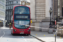 © Licensed to London News Pictures. 24/07/2016. LONDON, UK.  Police cordon around the bus at Threadneedle Street. A 26 year old man was stabbed outside Bank Tube station in Threadneedle Street near the Bank of England in the early hours of this morning. The man is then reported to have staggered onto the N242 bus, horrifying passengers. Ambulance and police emergency services were then called.  Photo credit: Vickie Flores/LNP