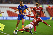 Nottingham Forest defender Danny Fox (13) makes a tackle against Shrewsbury Town midfielder Alex Rodman (23) during the EFL Cup match between Nottingham Forest and Shrewsbury Town at the City Ground, Nottingham, England on 8 August 2017. Photo by Jon Hobley.