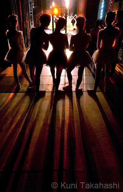 Ballerinas of Boston Ballet School watch an act from the backstage during a dress rehearsal of The Nutcracker in Boston.
