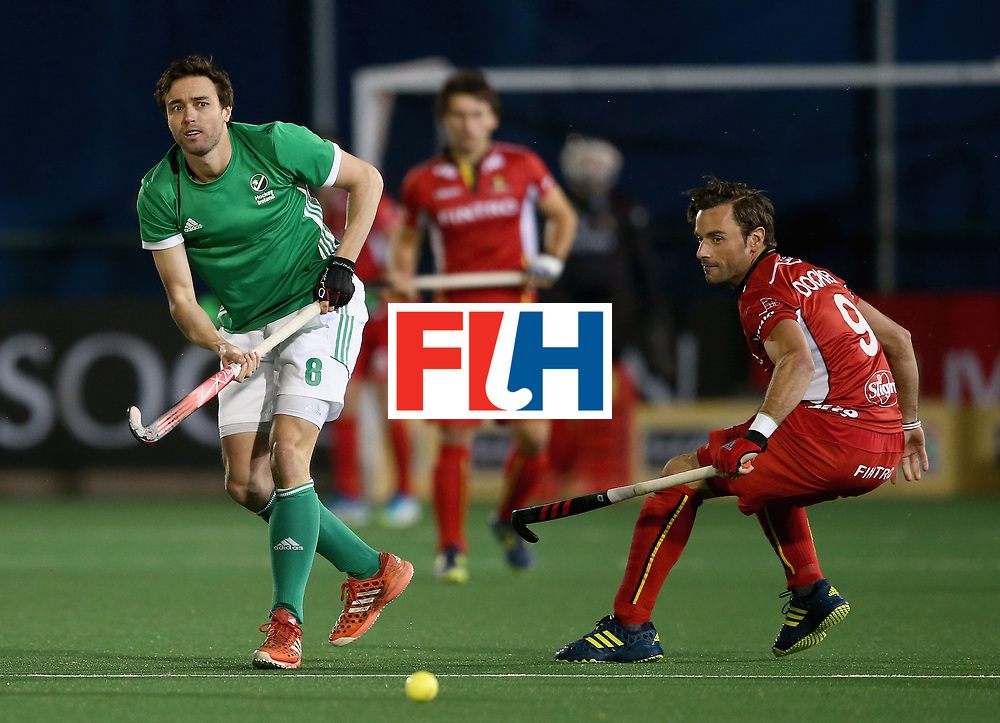 JOHANNESBURG, SOUTH AFRICA - JULY 11: Chris Cargo of Ireland passes the ball under pressure from Sebastien Dockier of Belgium  during day 2 of the FIH Hockey World League Semi Finals Pool B match between Belgium and Ireland at Wits University on July 11, 2017 in Johannesburg, South Africa. (Photo by Jan Kruger/Getty Images for FIH)