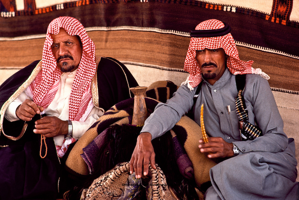 Shaikh of the Shammar tribe on the left in charge of establishing a permanent Bedouin settlement at Al Murut in the Nafud Desert, Saudi Arabia