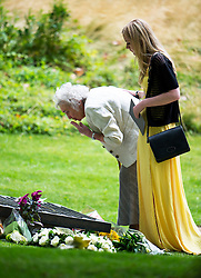 © Licensed to London News Pictures. 07/07/2015. London, UK. A young couple hug stood in the memorial as Family of those who lost their lives and survivors of the attack lay flower at the memorial during the service. A memorial service in Hyde Park London on the 10th anniversary of the 7/7 bombings in London. The event is attended by Prince William, survivors of the attack and family of those who lost their lives. Photo credit: Ben Cawthra/LNP
