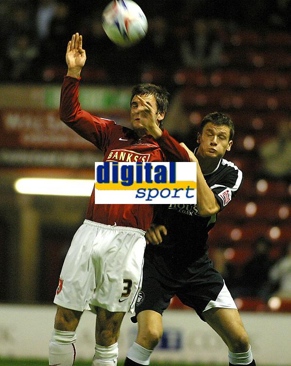 Photo: Dave Linney.<br />Walsall v Swansea City. Johnstone's Paint Trophy. 17/10/2006.Walsall's Daniel Fox (L) beats  Owain Tudur Jones to the ball.