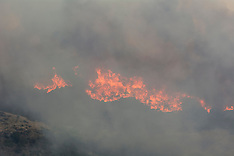 Christchurch-Fire crews and 3 helicopters are battling huge fire on Port Hills