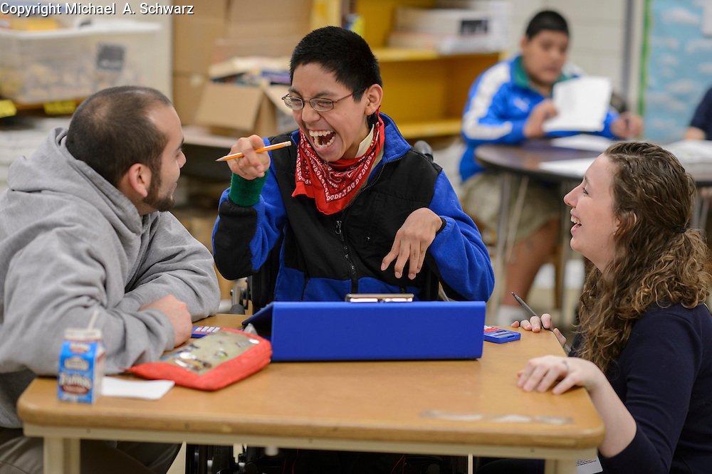 Doraville, GA. February 5, 2014.  Roberto Roblero is helped by his assistant Gariel Pineiro and his teacher Allison Bohl in Ms. Bohl's class at Sequoyah Middle School in Doraville, GA.<br />  --    Photo by Michael  A. Schwarz,