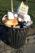 NYC public trash can with a Have A nice Day plastic shopping bag on top