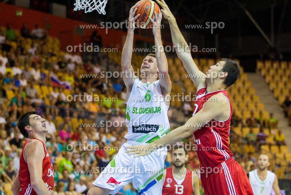 Luka Lapornik of Slovenia vs Cetin Serhat of Turkey during friendly match between National teams of Slovenia and Turkey for Eurobasket 2013 on August 4, 2013 in Arena Zlatorog, Celje, Slovenia. (Photo by Vid Ponikvar / Sportida.com)