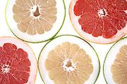 Slices of grapefruit on white bacground