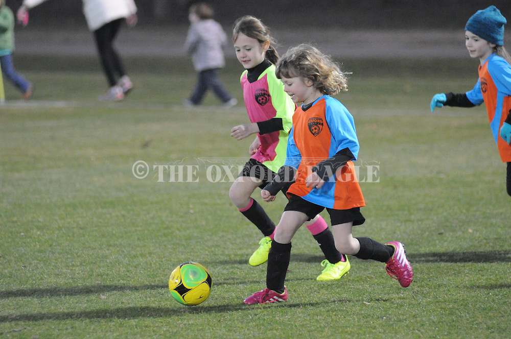 The Fillies' Kate Nordstrom (right) dribbles the ball upfield against the Blue Jays' Poppy Boling in Oxford Park Commission girls U6 soccer action at FNC Park in Oxford, Miss. on Tuesday, February 10, 2015.