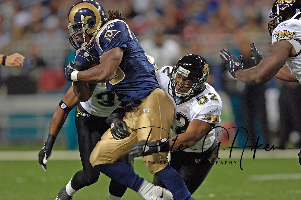 Jacksonville linebacker Daryl Smith (52) wraps up St. Louis running back Steven Jackson (39) during the first half at the Edward Jones Dome in St. Louis, Missouri, October 30, 2005.  The Rams beat the Jaguars 24-21.