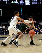Donald Carey (0) of Siena passes the ball past Bryce Moore (11) of Xavier during an NCAA college basketball game, Friday, Nov. 8, 2019, at the Cintas Center in Cincinnati, OH. Xavier defeated Siena 81-63. (Jason Whitman/Image of Sport)