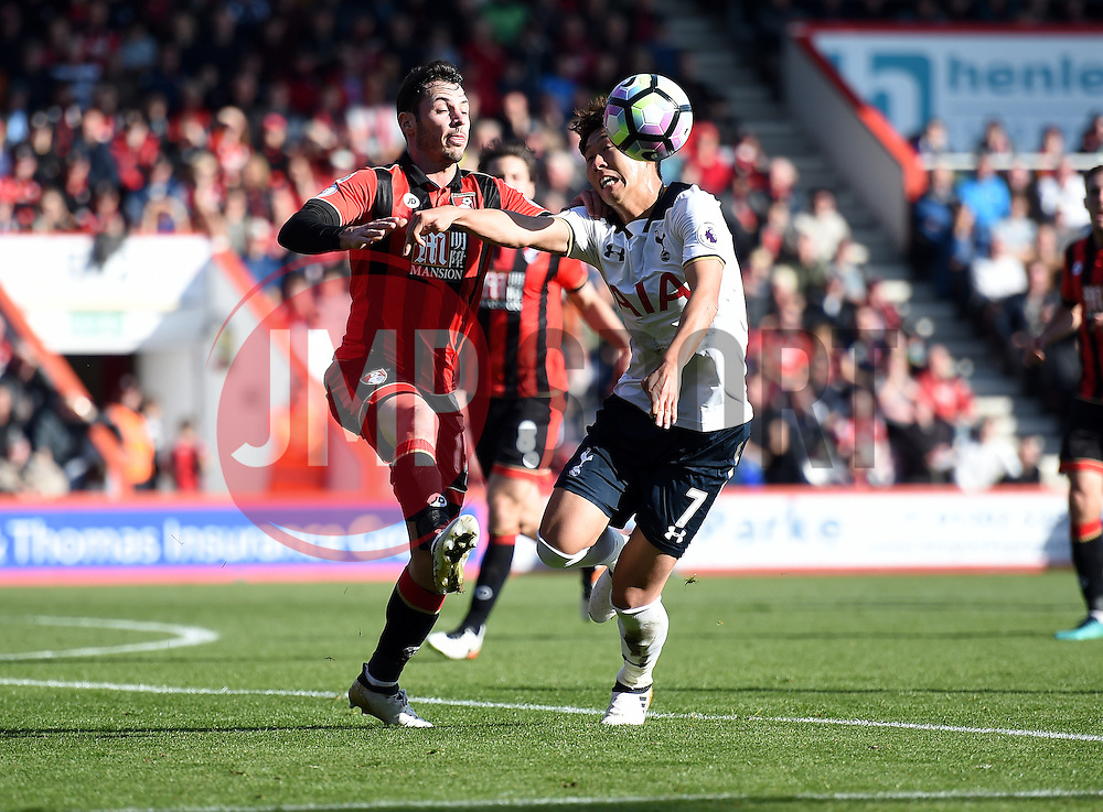 Son Heung-Min of Tottenham Hotspur battles for the ball with Adam Smith of Bournemouth - Mandatory by-line: Alex James/JMP - 22/10/2016 - FOOTBALL - Vitality Stadium - Bournemouth, England - AFC Bournemouth v Tottenham Hotspur - Premier League