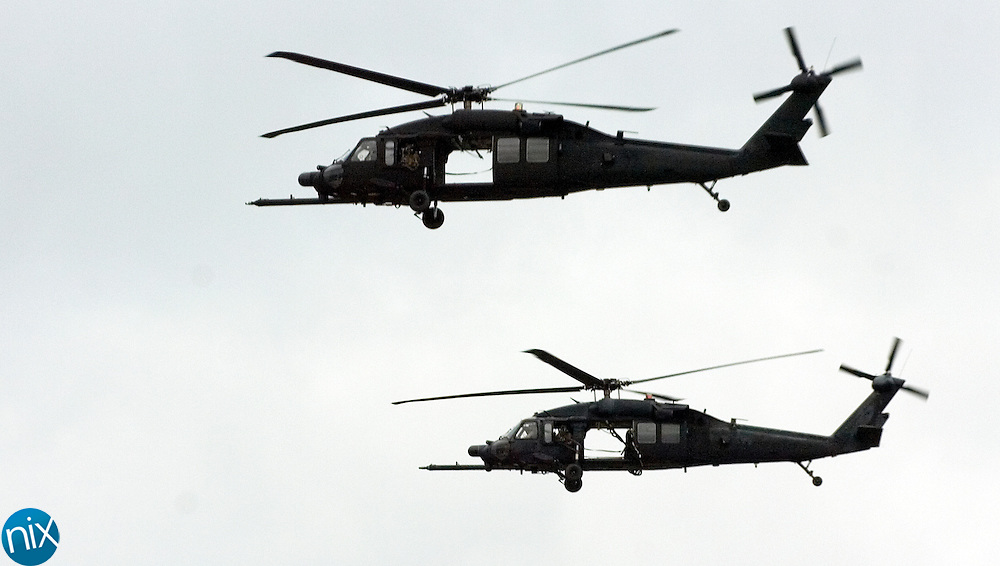"United States Army helicopters rehearse landing on the track for a pre-race demonstration along the front stretch of Lowe's Motor Speedway Monday morning. Prior to the Coca-Cola 600 on May 24, soliders will ""secure"" the track and make a special delivery."