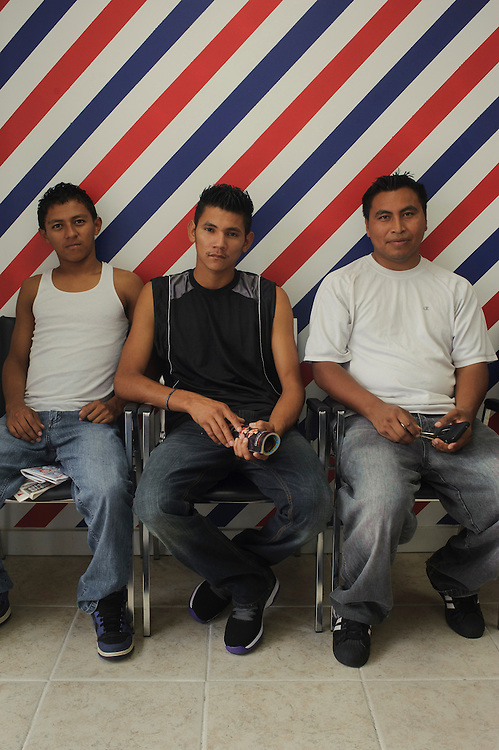 (left to right) William Garay, Ivan Chica and Mauricio Garay from El Salvador pose for a photograph while they wait for their turn at the Barber Shop in Brentwood. (July. 14, 2012)