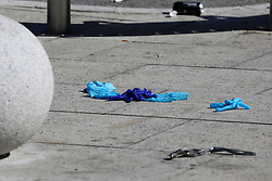 © Licensed to London News Pictures. 14/09/2019. London, UK. Medial gloves on the ground within the crime scene on Downham Way in Lewisham as a murder investigation has been launched by Met Police after a 34 years old man died in hospital. The victim suffered stab and head wounds on Friday 13 Sept following a fight inside Metro chicken shop on Downham way. A 51 year old man was also injured in the fight and has since been discharged from hospital and subsequently arrested in suspicion murder. Two other men aged 40 and 46 have also been arrested on suspicion murder. Photo credit: Dinendra Haria/LNP
