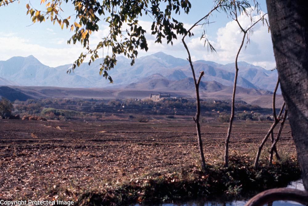 2-4 December 1976<br /> Stony fields. Qala in background.
