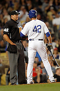 LOS ANGELES, CA - APRIL 15:  Casey Blake #23 of the Los Angeles Dodgers argues with home plate umpire Chad Fairchild after getting called out on strikes with runners in scoring position during the game between the St. Louis Cardinals and the Los Angeles Dodgers on Friday April 15, 2011 at Dodger Stadium in Los Angeles, California. (Photo by Paul Spinelli/MLB Photos via Getty Images) *** Local Caption *** Casey Blake