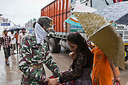 India Boarder guards (SSB) make regular searches of people and their possessions arriving from Nepal. This is the border crossing at Belahiya where Manav Seva Sansthan, MSS, have an anti trafficking project.