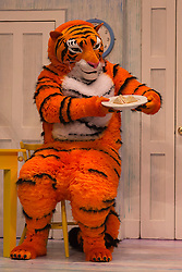 "© Licensed to London News Pictures. 03/07/2014. London, England. Matthew Dudley as The Tiger. The musical play ""The Tiger Who Came to Tea"" returns to London's West End. With Abbey Norman as Sophie, Jenanne Redman as Mummy and Matthew Dudley as the Tiger. The stage adaptation of Judith Kerr's tale is directed by David Wood. The show opens on 2 July and runs until 7 September 2014 at the Lyric Theatre in London. Photo credit: Bettina Strenske/LNP"