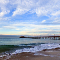 Newport Pier on Balboa Peninsula in Newport Beach Orange County Southern California. Photo is high resolution and wide angle with colorful clouds and sky.