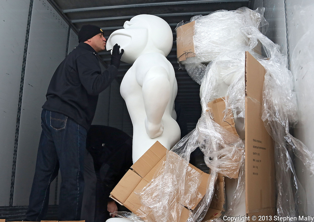 Dale Arens, Director of University of Iowa Hall of Fame and Licensing, kisses the first Herky On Parade statue as they unload the first shipment of 20 Herky On Parade statues in Coralville on December 12, 2013.