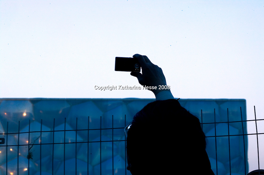 BEIJING, MARCH :7 : a man takes a picture of the of the Aqua Centre.