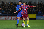 AFC Wimbledon defender Rod McDonald (4) battles for possession with Ipswich Town attacker Kayden Jackson (9) during the EFL Sky Bet League 1 match between AFC Wimbledon and Ipswich Town at the Cherry Red Records Stadium, Kingston, England on 11 February 2020.