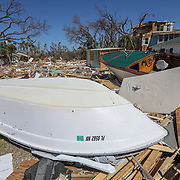 Boats and debris from homes are seen Friday, Oct. 12, 2018 in Mexico Beach. Residents of the small beach town of Mexico Beach began to make their way back to their homes some for the first time after Hurricane Michael made landfall Wednesday.