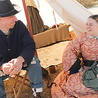 "Jeffery Palese, and Tabatha Palese with their infant daughter Hailey Palese Sunday February 8, 2015 during the 10th Annual Civil War Living History Weekend at Cameron Art  Museum. Jeffery has participated in reenactments most of his life and Tabatha began participating when they got married, ""I kinda drug her into it,"" admits Palese. Their daughter Hailey's first reenactment was at 1 month, The Battle of Ft. Fisher. The Weekend commemorated the Battle of Forks Road. (Jason A. Frizzelle)"