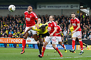 Nottingham Forest defender Michael Mancienne (4)  and Burton Albion striker Marvin Sordell (9) during the EFL Sky Bet Championship match between Burton Albion and Nottingham Forest at the Pirelli Stadium, Burton upon Trent, England on 11 March 2017. Photo by Richard Holmes.
