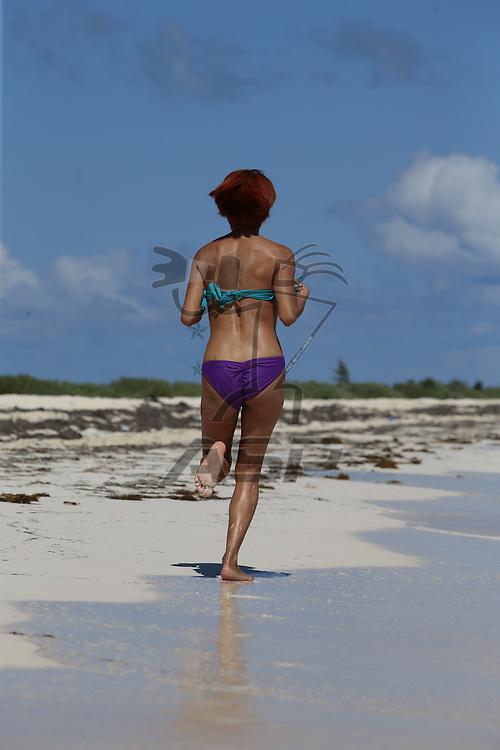 A hispanic brunette model enjoying the beach