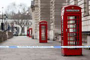 UNITED KINGDOM, London: 23 March 2017 A police cordon blocking access to Parliament Square and the famous red phone boxes which are popular with tourists this morning after a terror attack which killed four people including the attacker in Westminster yesterday. Rick Findler / Story Picture Agency