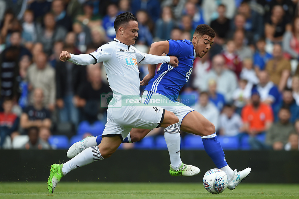 Swansea City's Roque Mesa (left) and Birmingham City's Che Adams (right) during the pre-season match at St Andrews, Birmingham.