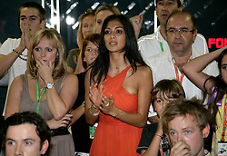 An anxious Nicole Scherzinger watches as Lewis Hamilton tries to claim forth position on the final lap of the Brazilian Formula One Grand Prix at the Interlagos Circuit on November 2, 2008 in Sao Paulo, Brazil... ..