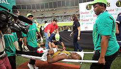10062018 (Durban) An athlete Joseph on the stretcher passing the finnish line at the Mosses Mabhida stadium venue during the Comrades Marathon on Sunday as Bong'musa Mthembu and Ann Ashworth ensured that the coveted titles remained on these shores.<br /> Picture: Motshwari Mofokeng/African News Agency/ANA