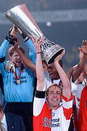 Photo: Gerrit de Heus. Rotterdam. UEFA Cup Final. Feyenoord-Borussia Dortmund. Captain Paul Bosvelt with the Cup. Keywords: beker