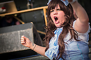 UNITED KINGDOM, London: 27 May 2016 A young cosplay fan dressed as Alice in Wonderland sings along to heavy metal music at the MCM London Comic Con held all this weekend at The ExCeL Centre. The comic convention will see an estimated 150,000 cosplay and comic fans flock to the exhibition. Rick Findler / Story Picture Agency