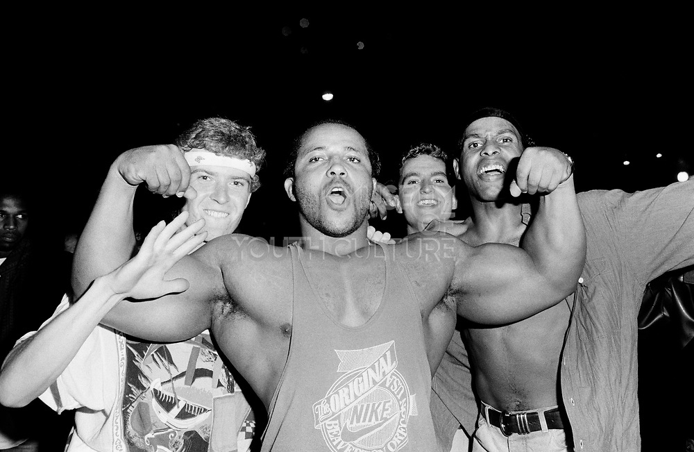 A body builder poses outside The Trip with other Ravers, Astoria, London 1988