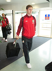 CARDIFF, WALES - Monday, September 10, 2012: Wales' Ben Davies arrives at Cardiff Airport as the side travel to Serbia for the 2014 FIFA World Cup Brazil Qualifying Group A match in Novi Sad. (Pic by David Rawcliffe/Propaganda)