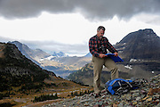 Dan Fagre Ph.D., a research ecologist with the USGS at the base of Mount Clements at Logan Pass, Glacier National Park, Montana , Tuesday, October 7, 2014. Fagre is using repeat photography to document disappearing glaciers using photos taken in the 1880's (first exploration of this area by people with cameras) and since, and comparing them with the present day images he takes in the exact locations of the historic images to study and document the rate at which glaciers are disappearing.
