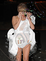 Lady GaGa leaves the Roundhouse after her ITunes festival gig,  wearing a white bubble mini dress that blowed bubbles. London, UK. 01/09/2013<br />