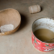 Brown, muddy water used for cooking and drinking is seen in a tin at the home of the Ouedraogo family in Koala, Burkina Faso on 27 February 2014. In the absence of an accessible improved water source, community members rely on a dam which is also used by animals, and a small number of shallow, hand-dug, low-yield wells.