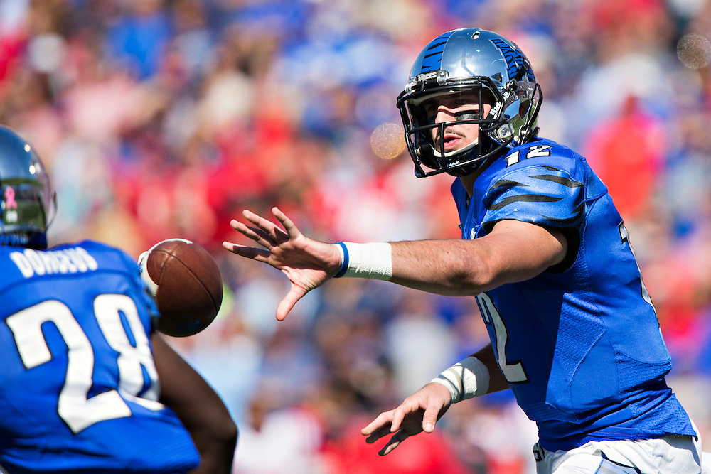 MEMPHIS, TN - OCTOBER 17:  Paxton Lynch #12 makes a pitch to Doroland Doreus #28 of the Memphis Tigers during a game against the Ole Miss Rebels at Liberty Bowl Memorial Stadium on October 17, 2015 in Memphis, Tennessee.  The Tigers defeated the Rebels 37-24.  (Photo by Wesley Hitt/Getty Images) *** Local Caption ***  Paxton Lynch; Doroland Doreus