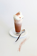 Hot Chocolate milk topped with whipped cream on white background