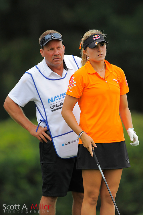 Lexi Thompson and her caddie/father Scott Thompson during the first round of the CME Group Titleholders at Grand Cypress Resort on Nov. 17, 2011 in Orlando, Fla.  ..©2011 Scott A. Miller