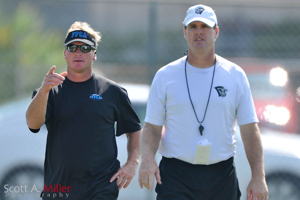 Sep. 2, 2010; Orlando, FL, USA; Former NFL coach and now Monday Night Football commentator Jon Gruden, left, talks with his brother Jay  during training camp for the Florida Tuskers at Thunder Field. Jays Gruden is the Tuskers head coach..©2010 Scott A. Miller